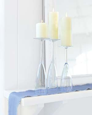 Champaign flutes, flipped, used as candle holders. I'll never think of these the same way at secondhand stores.