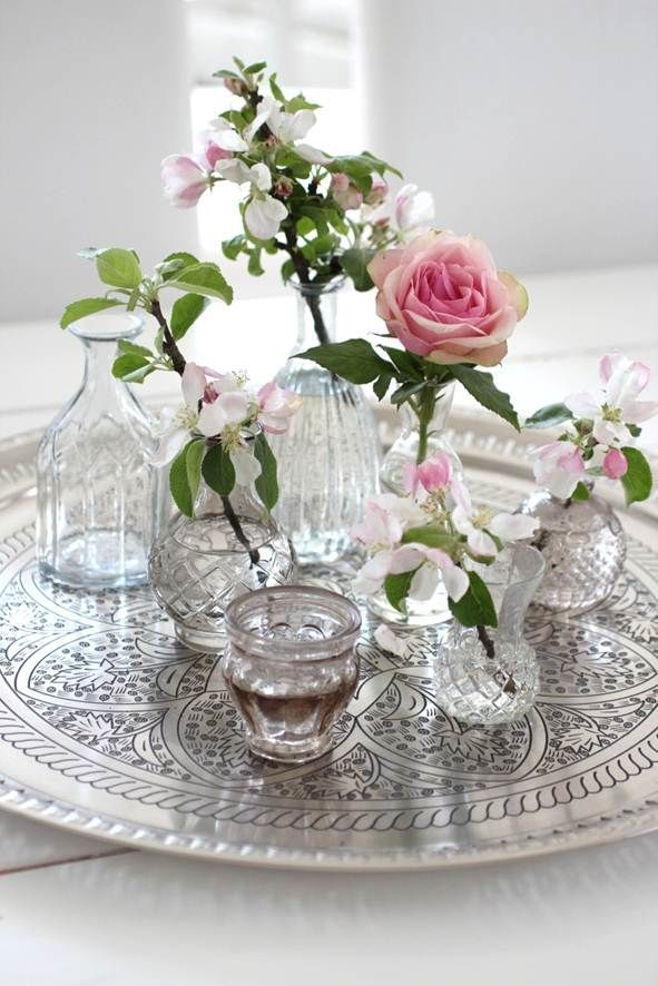 Roses and glass wases on a silver tray