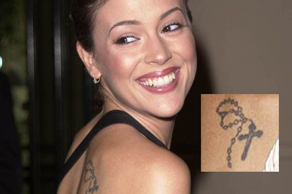 """Alyssa Milano has a rosary on her back in addition to a cross and angel on her ankle with the initials of an """"ex flame."""""""