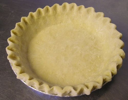 "Low Fat Pie Crust - for homemade pop tarts & pies :)  NO CHOLESTEROL - LOW FAT - PIE CRUST	  1 1/3 c. flour 1/2 tsp. salt 1/3 c. oil (Puritan, Canola, etc.) 3 tbsp. skim milk Combine flour and salt in bowl. Blend oil and milk in bowl. Add to flour mixture. Stir with fork until forms large clumps. Press into ball. Flatten to form 5-6 inch ""pancake"". Roll between sheets of wax paper. Peel off top sheet. Flip into 9 inch pie pan. Remove other sheet. Press dough into pie plate. Trim and flute."