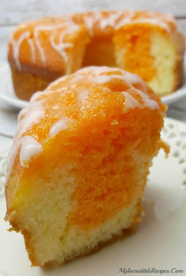 This Orange Creamsicle Cake is an orange lovers dream come true. It is SO easy to make and uses a secret ingredient that makes the cake light and fluffy! via @bestblogrecipes