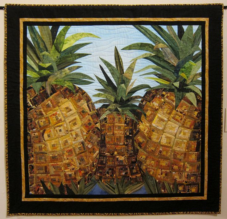 Pineapple Trio log cabin quilt by Margaret Teruya. Featured artist, Hawaii Quilt Guild Annual Exhibition, April 2014.  Photo by m j c at Flickr.
