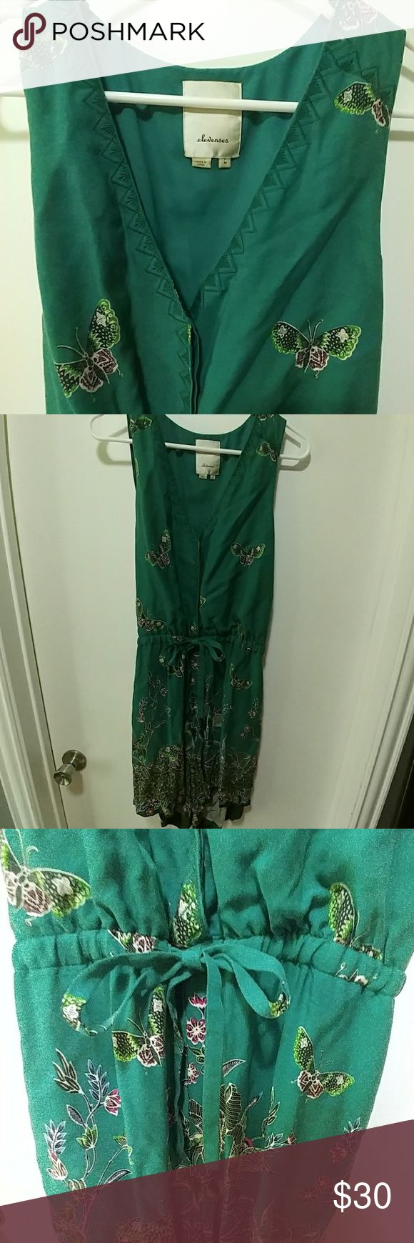Anthropologie elevenses butterfly romper Darling little romper from elevenses in kelly green with floral and butterfly print. Tie and sinch waist line and button down front. Elastic waist band in back for shorts part. Fits tts imo and has a super cute cross back flap detail in back see photos. Anthropologie Pants Jumpsuits & Rompers