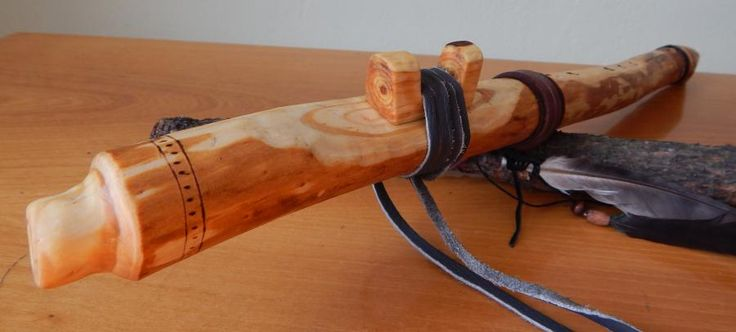 Native American Style Flute, made of spruce branch in the key of A, tuned to A=432 Hz.