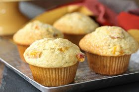 These Fresh Peach Muffins from Karen's Kitchen Stories are light, fruity, and just a little sweet. They are the perfect summer breakfast treat.