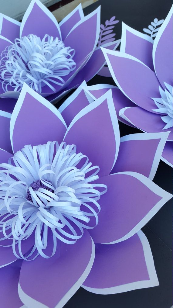 This is a set of 4 flowers and 8 tropical leaves in lavender and white. 4 medium - 12- 15 8 tropical leaves  CUSTOM ORDERS WELCOME!!! Send me a custom order request with color preference and date of your event. I use only high quality and acid free papers to create my flowers. This listing can be made in any size or color combination. Each flower is individually designed and custom made by me.  My paper flowers can also be customized with business logos, names, dates etc…