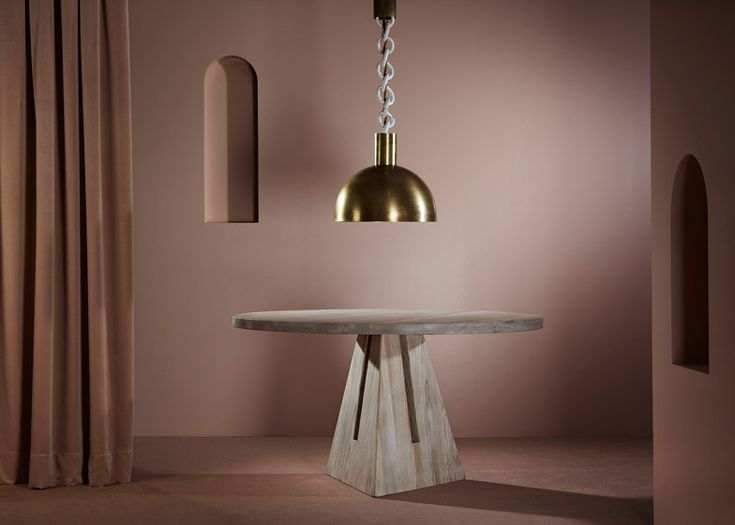 Apparatus uses metal cylinders and porcelain chains for new lighting designs.
