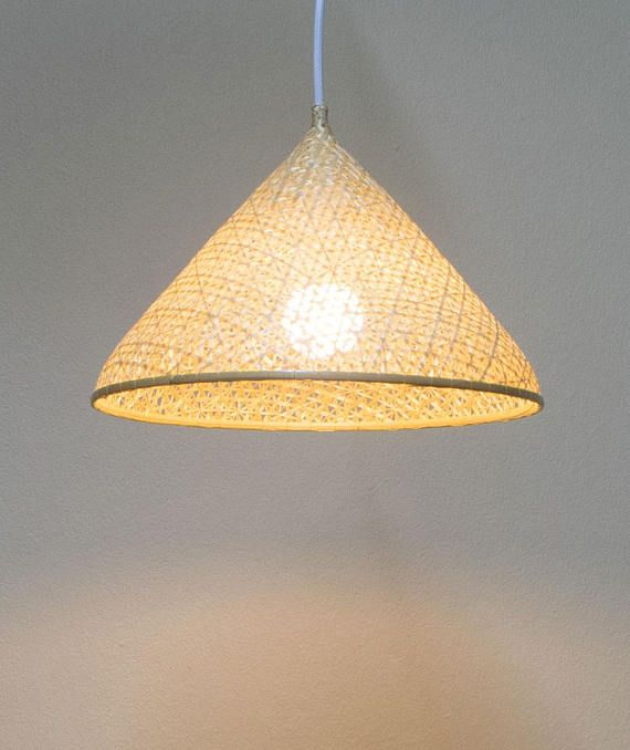 A traditionally handwoven Thai bamboo bowl piece, re-purposed into a beautifully minimalistic pendant light. [ About ] A classic example of Asian craftmanship, weve added a simple yet precise hanging lamp holder that can be adjusted with an adjustable metal support bracket so that you