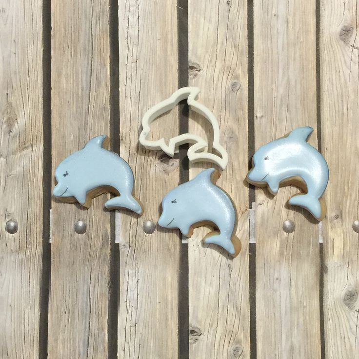 Dolphin cookies making a splash. Made by Andrea Young. Cookie cutter available on cookiecutterkdom.com