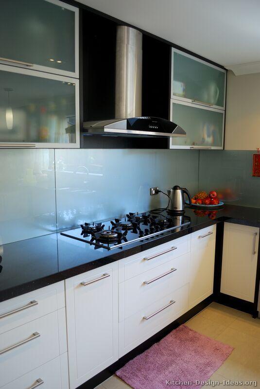 #Kitchen Idea of the Day: Modern Two-Tone Kitchen with a paneled glass backsplash.