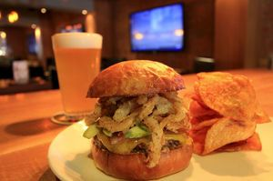 At Henry's Tavern in Sodo, the peanut-butter burger, also called the Peanut Buster burger, is on the happy-hour menu.