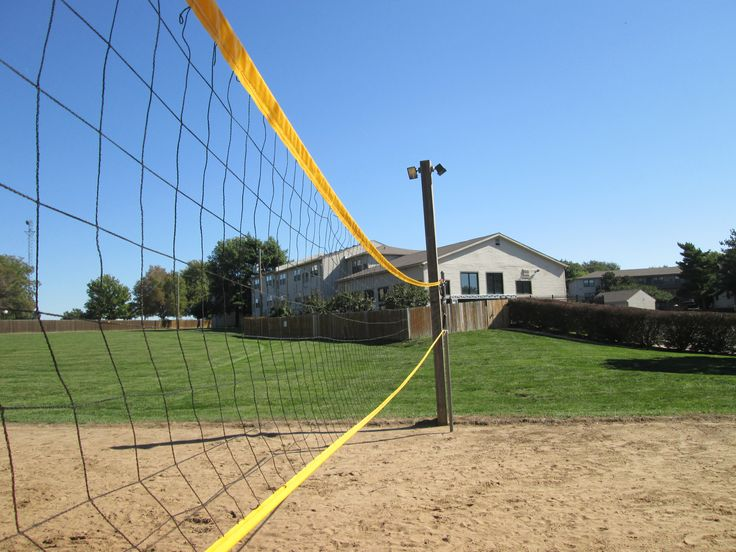 how to build a sand volleyball court in backyard