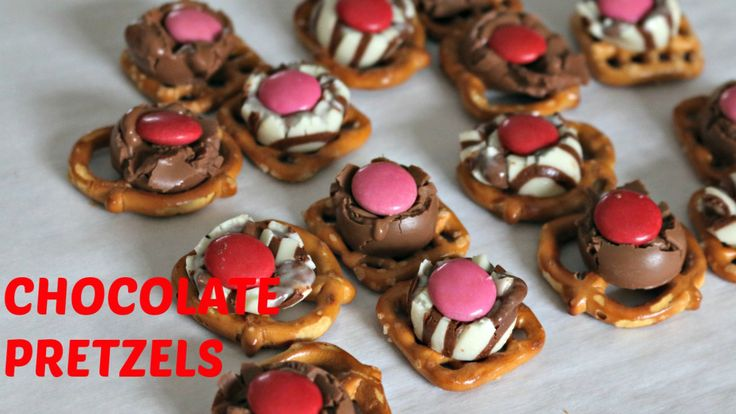 Video Tutorial: Ingredients: 24 Mini Pretzels 24 Hersheys Hugs and Kisses 24 Red and Pink M&Ms Directions: Preheat oven to 350ºF Place pretzels on a baking sheet and place a hug/kiss on top. ...