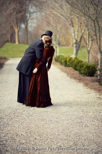 Trevillion Images - victorian-couple-kissing-in-park