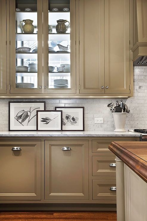 Taupe cabinets with marble counters and backsplash via Tom Stringer