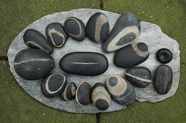 black stones by Jos van Wunnik,
