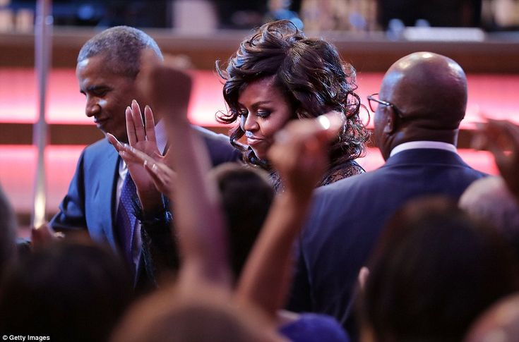 The Obamas are pictured appearing to belt a move during Friday night's event. The show was...
