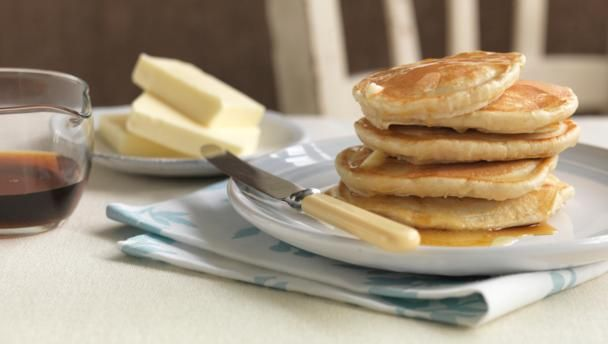"These pancakes are light and fluffy and great for a weekend brunch. Try  adding a large handful of fresh blueberries to the batter before cooking.  Read our <a href=""http://www.bbc.co.uk/guides/zy73gk7"">guide to supercharging your pancakes.</a>"