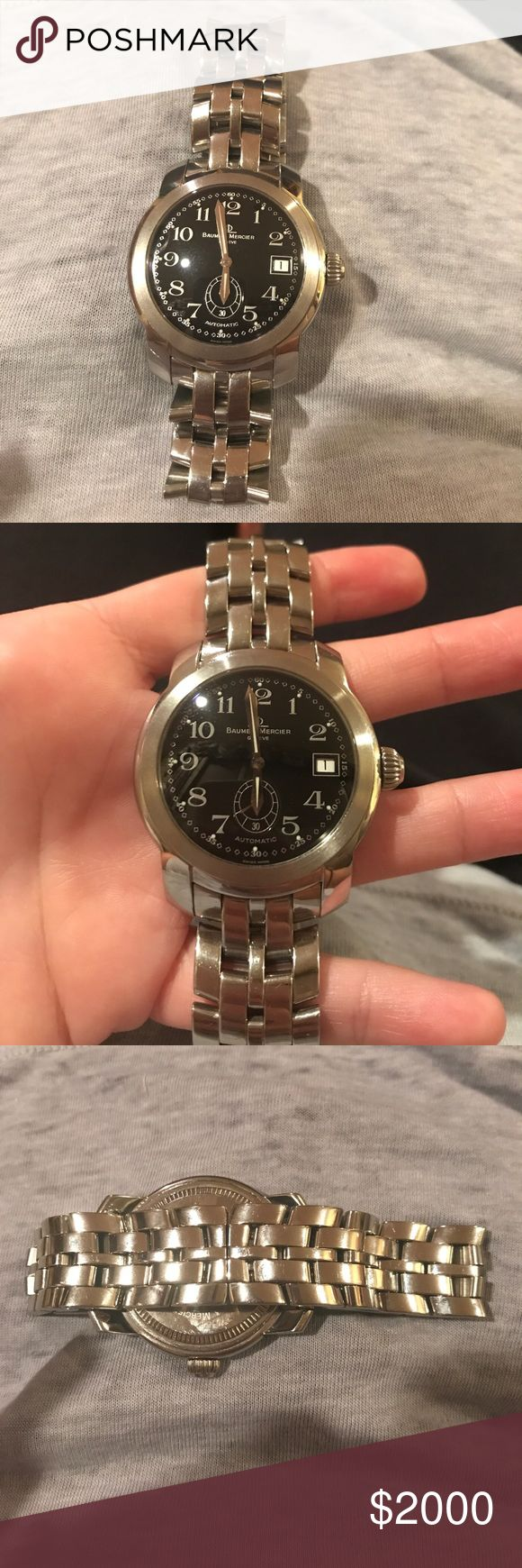 Baume & Mercier Swiss luxury watch Women's luxury watch. Brand new never worn. Silver with black face. baume & mercier Jewelry