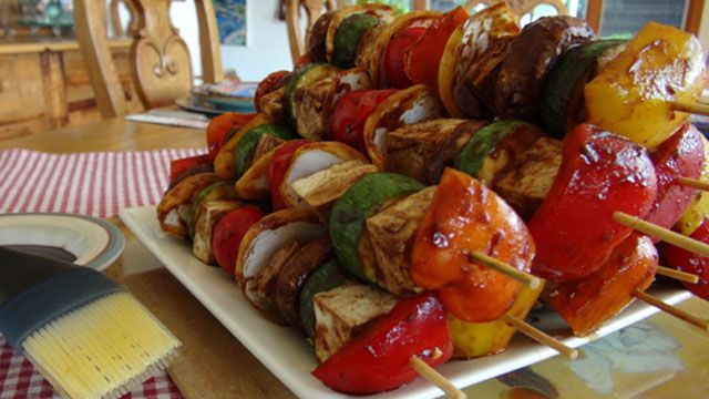Grill up this tofu shish kebabs recipe with sweet peppers, onions, zucchini, mushrooms and tomatoes. Serve over a bed of quinoa.