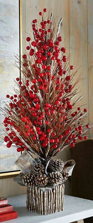 Faux berries + frost pine cones + faux sticks = holiday display