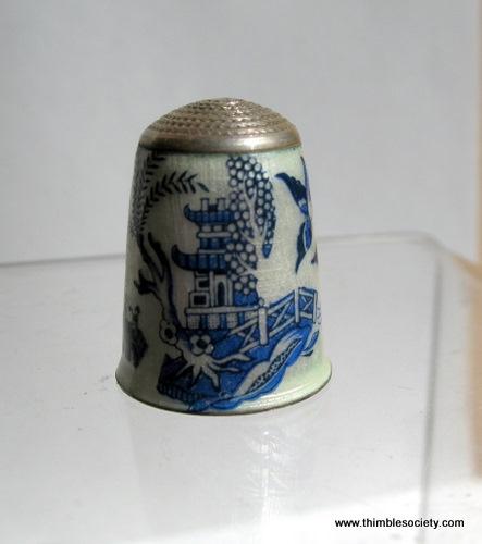 Enamel on silver, English cir 1980s. A willow pattern scene in enamel on a silver body.