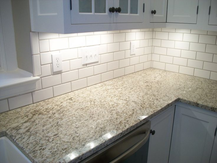 Giallo Ornamental Granite; may also work better with the warm floor color