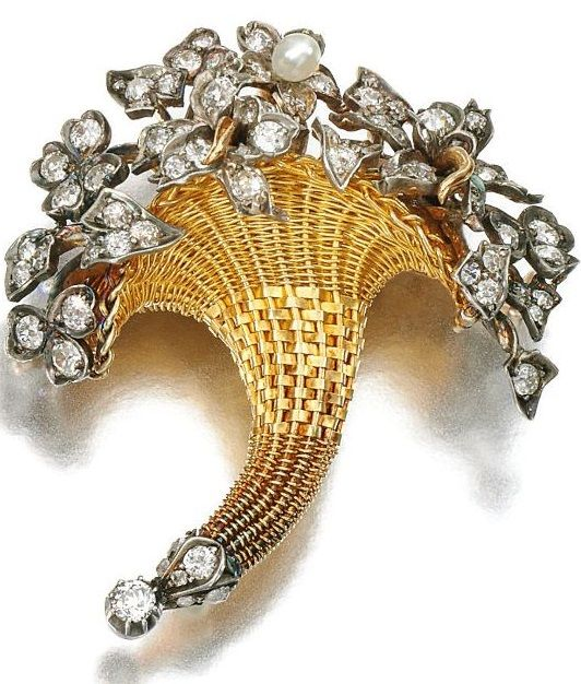 An antique gold, seed pearl and diamond brooch/pendant, Late 19th Century. Designed as a cornucopia, set with a seed pearl, circular-, single-cut and rose diamonds, detachable brooch fitting.