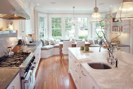 Stunning White Kitchen With A Corner Sofa And Smart Storage | DigsDigs