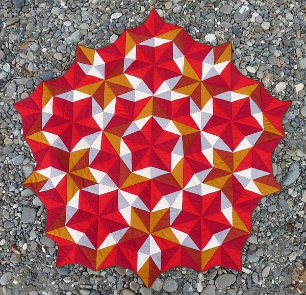 By George Hart for the Museum of Mathematics The traditional craft of quilting can be used to make many mathematical forms. While quilters have always used geometry to work out repeating patterns, ...