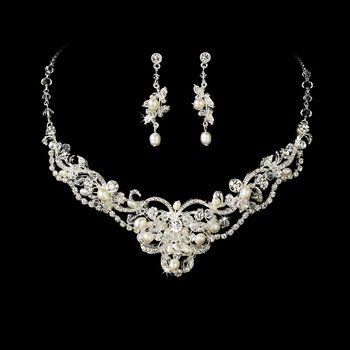 $79.99 Elegant and ornate, this bridal necklace and earring set features exquisite silver plating, ivory freshwater pearls, clear rhinestones, and Swarovski crystals. This set coordinates beautifully with your white or ivory wedding dress.