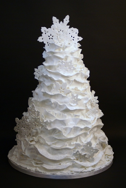 Pure White Winter Wedding Cake Ruffles And Snowflakes