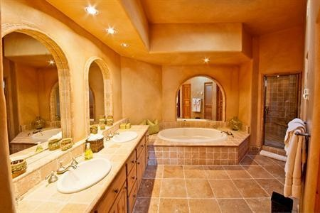 Rustic & Southwestern appeal, his/her sinks, separate shower & bathtub. Enough space for a party of women to get ready together -- very roomy!