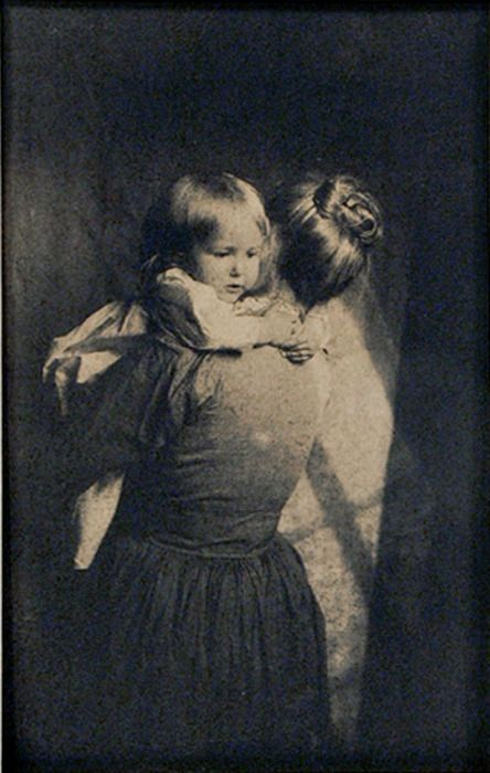 "liquidnight:    ""Mothers arms are made of tenderness, and sweet sleep blesses the child who lies within.""  —Victor Hugo, Les Miserables  Pictorialist Style Mother Holding Child, Platinum print, circa 1915  [Photo from the Rodger Kingston Collection]"