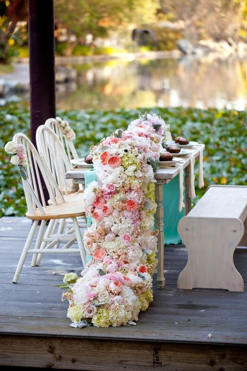 designed by blush botanicals this cascading floral table runner included peonies textured garden roses and hydrangea with more than 15 other flower