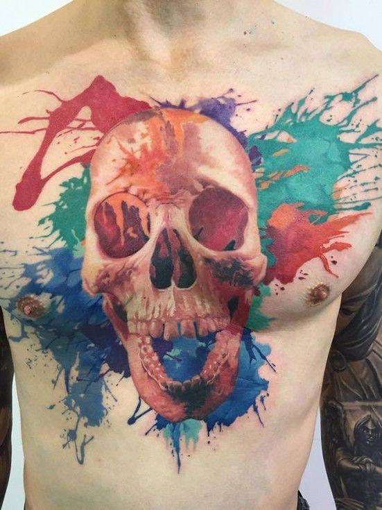 Skull paint splatter tattoo