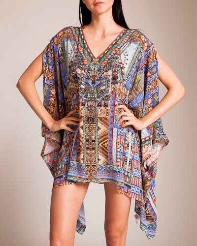 Go Your Own Way Split Shoulder Kaftan. Celebrated designer and artist Camilla Franks is a name synonymous with Australian fashion and lifestyle. Each Camilla piece is infused with story: the destination and adventure are yours to fill with vibrant color, digital print, bohemian detailing and intricate craftsmanship.