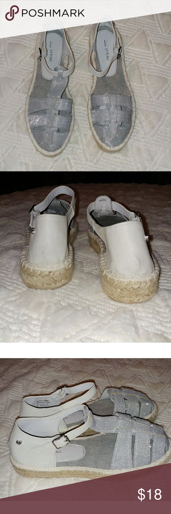Call it spring silver espadrille sandals 8 nwot Call it spring silver espadrille sandals size 8. These are brand new, there is a tiny on the right shoe near the bottom, it is pictured. Call It Spring Shoes Espadrilles
