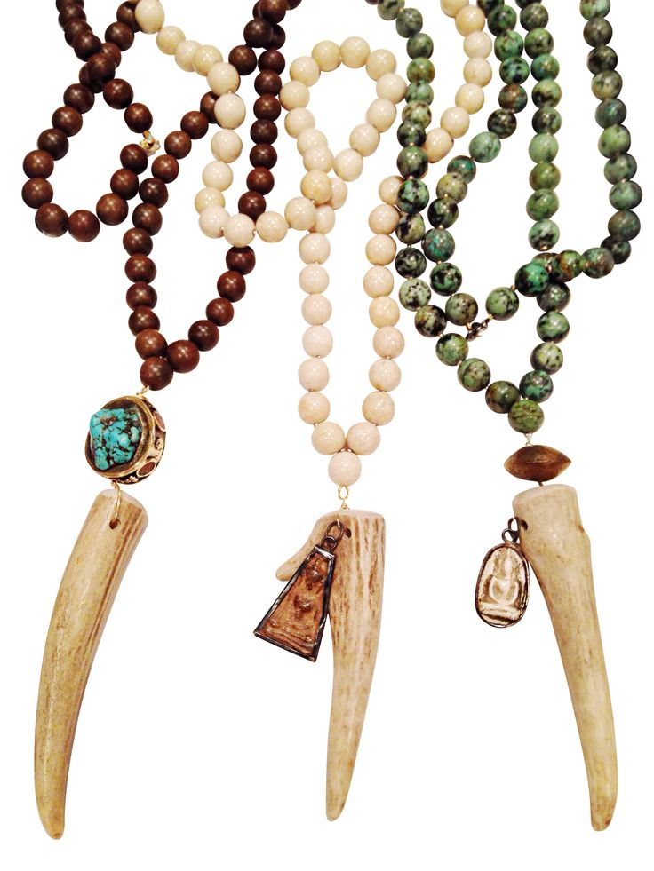 """The Antler Tip Necklace Collection features three different hand Beaded Necklaces! Perfect for everyday wear, these necklaces are versatile, yet make a statement. 1) Turquoise Pendant Antler Tip Necklace Featuring a Turquoise Pendant, with Tibetan Wood Prayer beads Authentic Antler Tip Measurements: 32"""" 2) Beaded Agate Meditation Antler Tip Necklace Featuring Cream colored round Agate Beads and a vintage meditation charm Authentic Antler Tip Measurements: 32"""" 3) Beaded African Turquoise ..."""