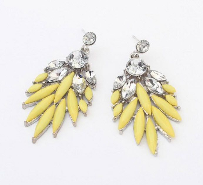 Lana: Perfect for vacation, these earrings are colorful and vibrant. We recommend to match bright lipstick colors to the earring of your choice.