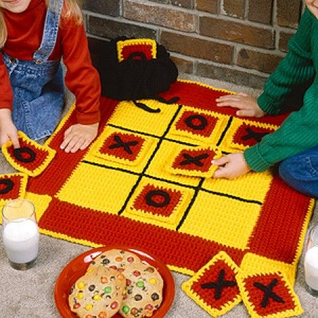 """Your youngsters will have tons of fun playing with this quick-to-stitch, large, and cushy soft crocheted Tic-Tac-Toe game board and pieces. Complete with storage bag, our designs are crocheted using two strands of worsted weight yarn and sizes G (4.50 mm) and I (5.50 mm) hooks. <br><br/>This digital project includes: patterns for one 24"""" square game board, plus game pieces and storage bag.<br>"""