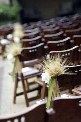 Wheat aisle chair décor for a fall wedding. Source: Project Wedding. #aislechairdecor #weddingchairs #wheat