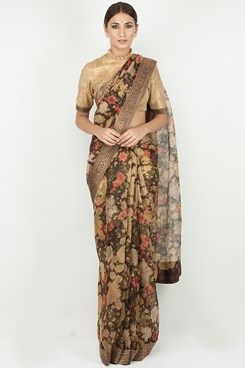 05d120725b080af8f15df526d532e5c0 indian attire indian wear - Featuring a chocolate brown, beige and coral floral printed organza saree with a...
