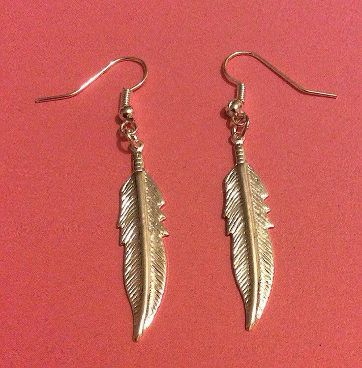 A personal favourite from my Etsy shop https://www.etsy.com/uk/listing/264524982/feather-earrings