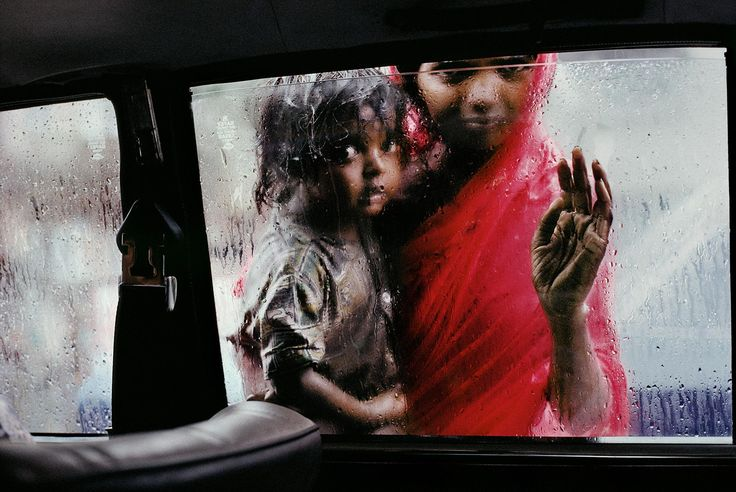 Mother and Child at Car Window    INDIA-10214