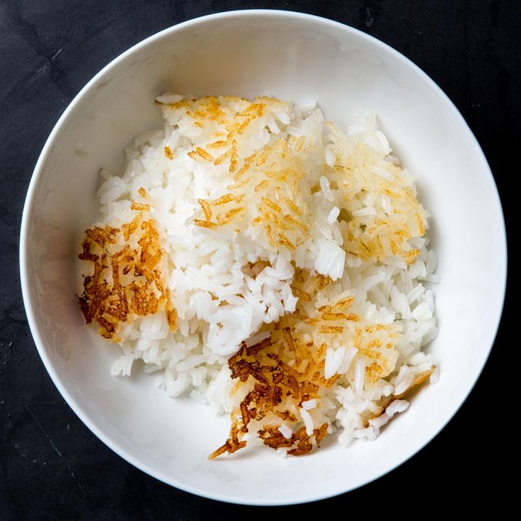 The Only Thing Better than Plain Rice Is Crispy Rice - 1/3 cup vegetable oil, 3 tbsp milk, 6 cups cooked white rice and 3 tbsp water. Wrap lid with towel to prevent moisture from leaking into the pot, cover, and cook on medium-high heat for 10-15 minutes