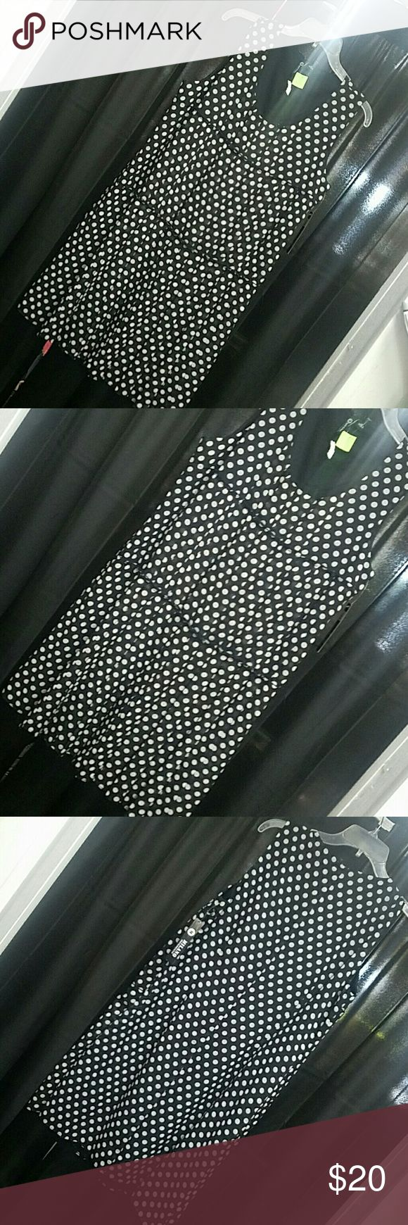 MILANO Black & White Polka dot dress NWT. I love this dress. Pairs great with flats or heels. Great for work or play. Would go great with a sweater or cardigan in the fall.   **All of my items ship with a free gift with your purchase** Milano Formals Dresses
