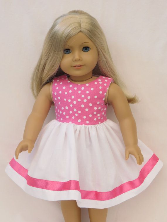 Pink and White Dress for American Girl doll by DollClothesbyTrudy, 10.99.  The bodice is a pink and white polka dot pattern and is completely lined. The full skirt is white broadcloth with an accent of matching pink grosgrain ribbon. The sleeveless style and open back make for ease of dresing for the girls. The back closes with velcro