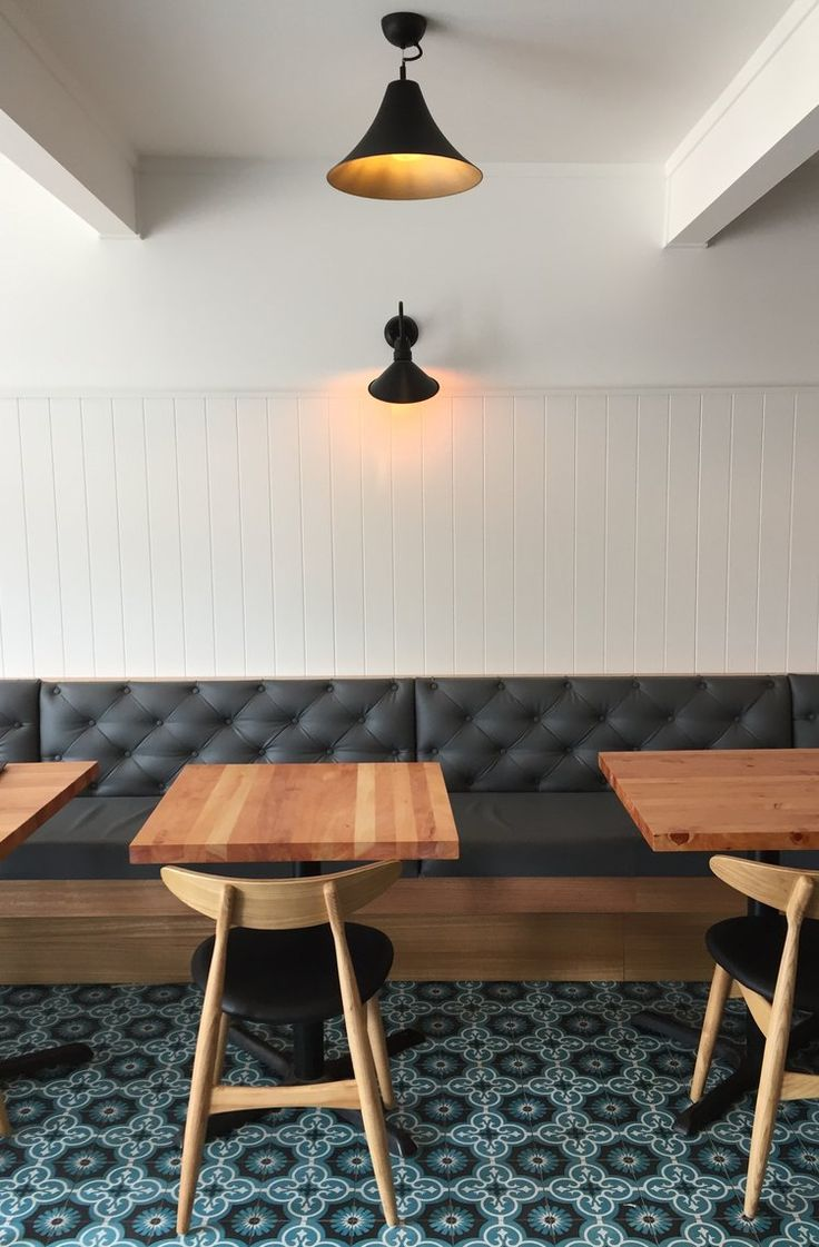 Kuzina cafe restaurant. button upholstered bench seat, wegner chair and solid timber cafe table.