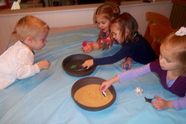 "Cinnamon graham cracker ""sand"" with beach creatures"